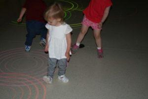 Isabelle playing with interactive floor lights