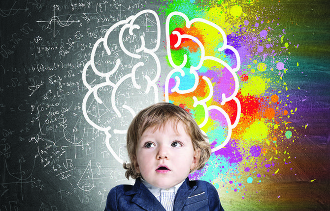 Little boy and a colorful brain sketch